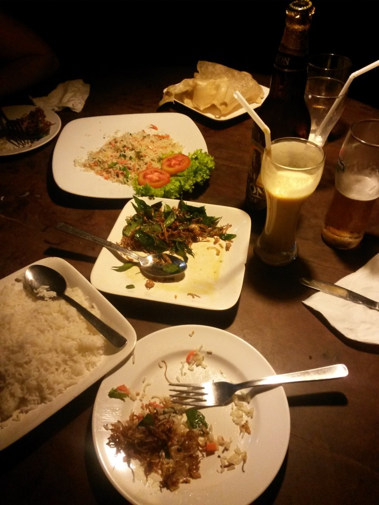 Our first night eating out: veg fried rice, fried onion curry, steamed rice, mix fruit milkshake and a beer - around 1750 rupees