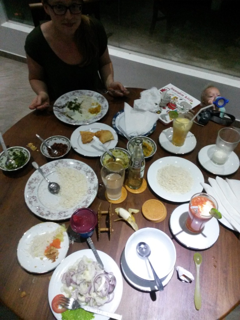 Our first time dinner, almost already eaten, at the excellent Glass House restaurant - veg soup (that empty bowl), rice & curry, onion & cucumber salad and pineapple and watermelon juices. Total price 1000 rupees.