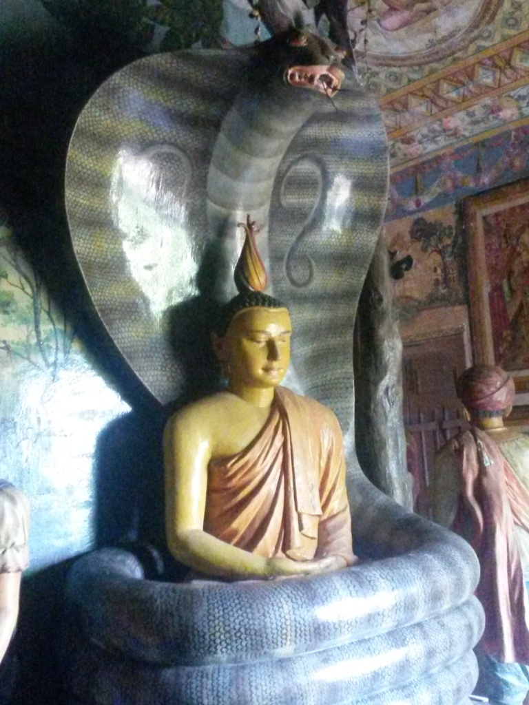 A cobra buddha at the local temple