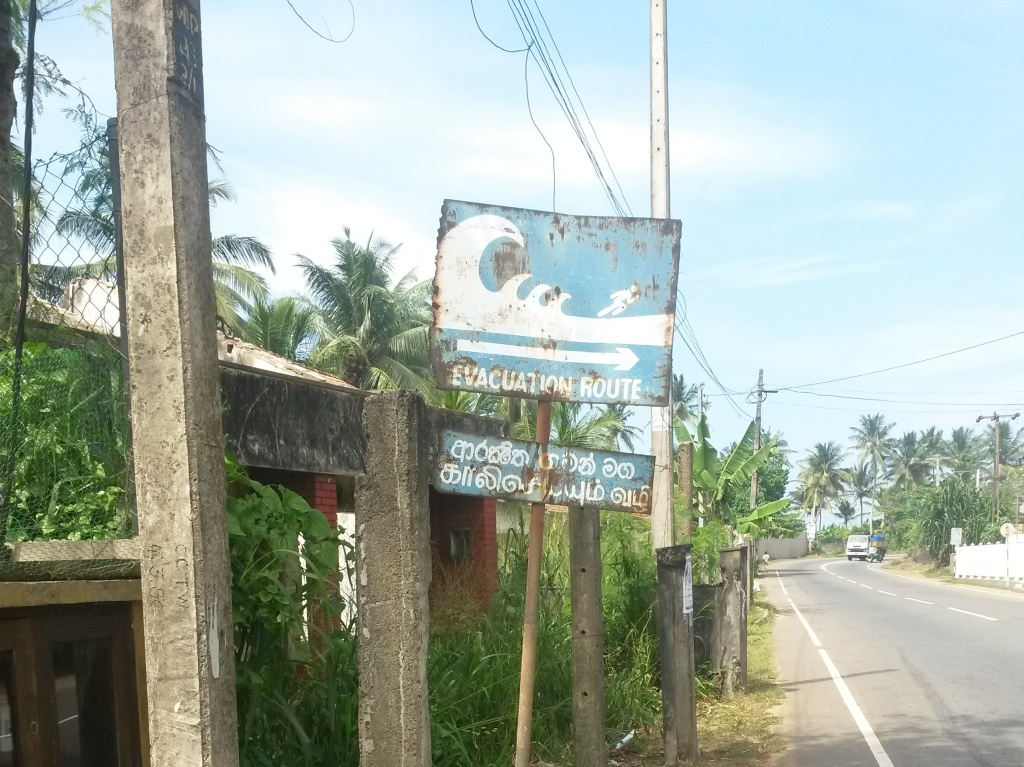A signpost pointing out the evacuation route in case of tsunami