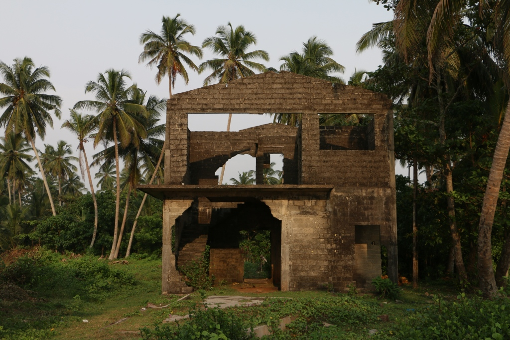 Along the Galle Road, ruins of tsunami-devastated houses still stand