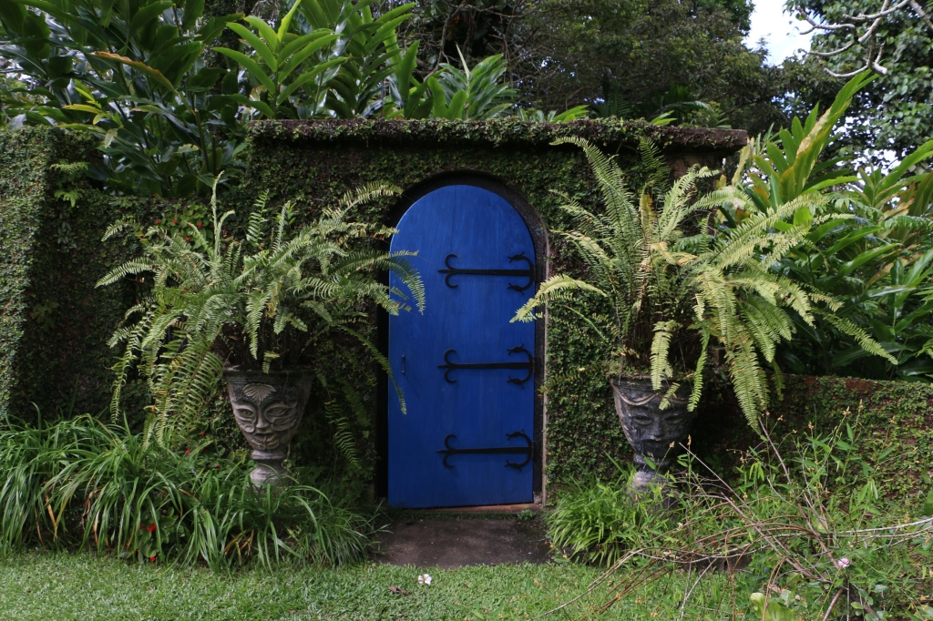 Blue door guarded by potheads