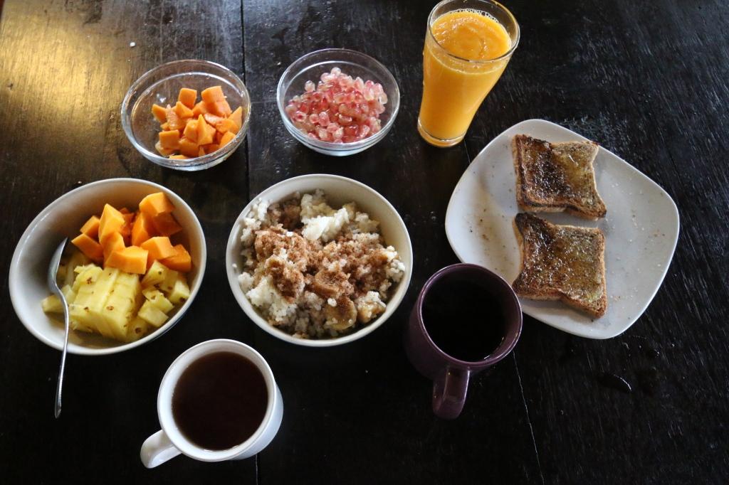 Christmas day breakfast: rice porridge made with coconut milk, fresh fruit & juice, toast with pineapple marmelade