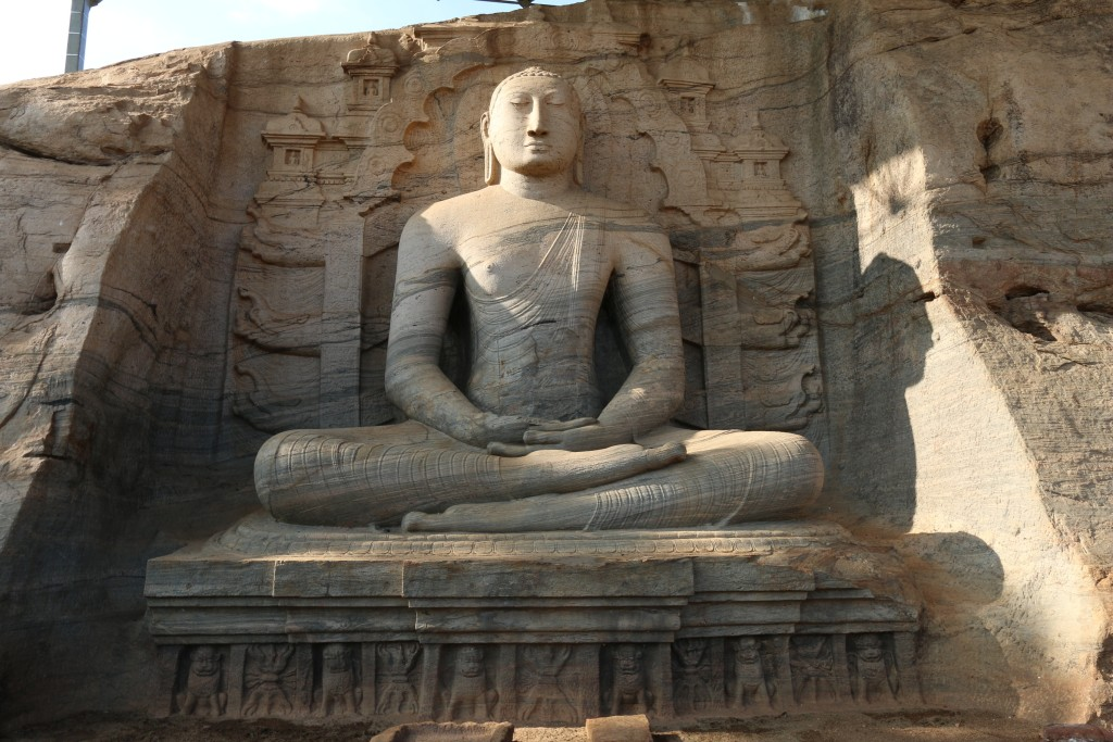 Gal Vihara consists of four images of Buddha, all cut from a single slab of granite