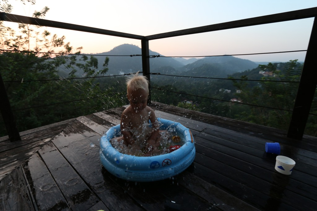 Eero having a splash at our balcony just moments before the sunset. The last few days were blessed with good weather and we could take to pool outside instead of the murky bathroom.