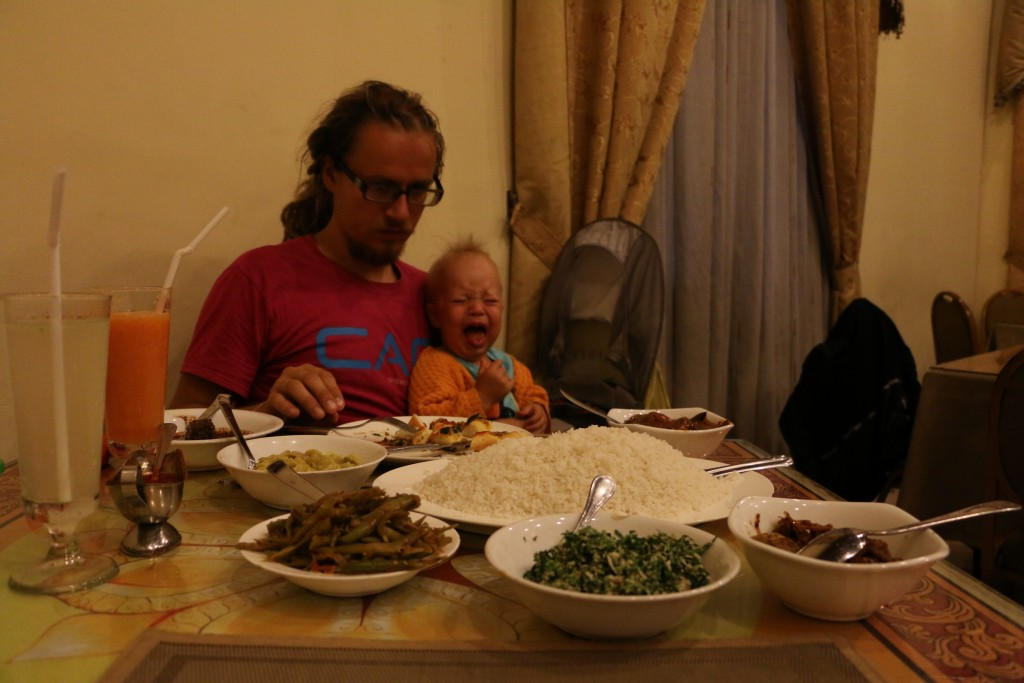 In some places if you order the rice & curry for two, you get them in shared plates like here. Then you will probably get even more food than having separate portions - ev''en too much! Eero's expression also gives out the spiciness of these curries.