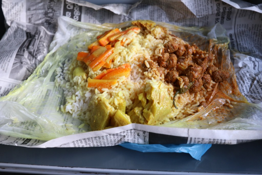 Take-away rice & curry from a railway station restaurant. Neatly packed in a plastic and newspaper wrapping. Special here is the soya curry on the right. This one was a bit spicy as the restaurants main clientele is just the locals.