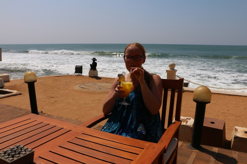 Maiju sipping a drink at the Galle Face Hotel waterfront bar. This was one option for us to stay, but it was currently under a major renovation process. If the renovations would have been over already, it certainly would have been a superb (although pricey) option.